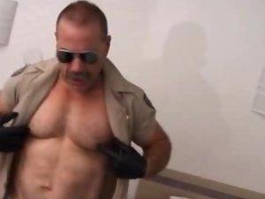 Muscled Gay Bear Masturbates In Uniform