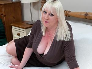 Big breasted mature slut going wild