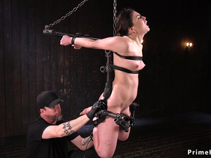 Brunette strapped and suspended tormented