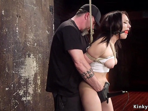Hogtied brunette gagged and toyed