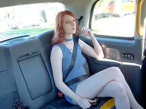 American redhead fucks in UK taxi