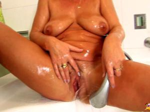 soapy mom masturbating with showerhead