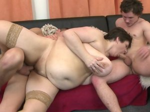 Huge breasted BBW fucking two toy boys at once