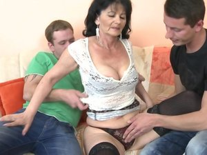 Horny housewife fucking two guys at once