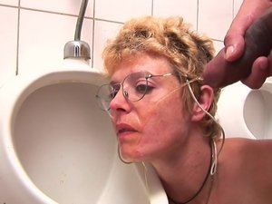 Horny blonde mature slut sucking cock on the toilet