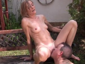Slim MILF with tiny tits Kimberley gets fucked in side to side pose on green grass